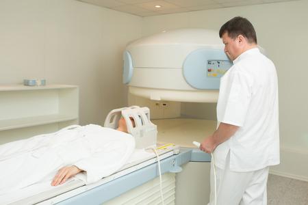 imaging: doctor examining woman at Magnetic resonance imaging