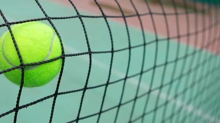 Tennis yellow ball in net. creative background Stok Fotoğraf