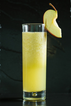clarified: apple fresh juice in glass isolated on black