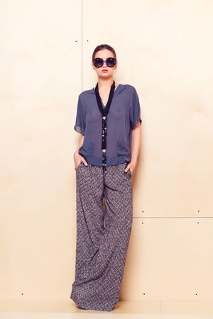 pantsuit: Full height portrait of a young woman in a bright pantsuit
