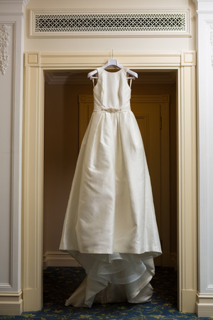hanging up: wedding dress hanging up by the door