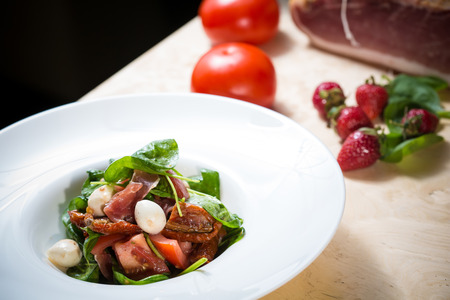 balsamic vinegar: Salad with strawberry, prosciutto, herbs, cottage cheese and  balsamic vinegar. Shallow dof.