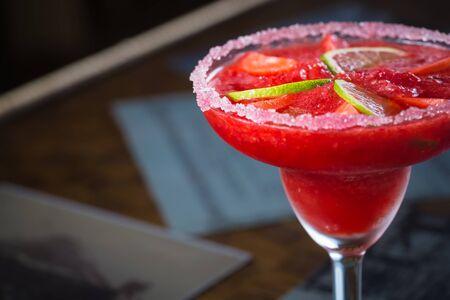 Strawberry margarita cocktail on the bar. Shallow dof