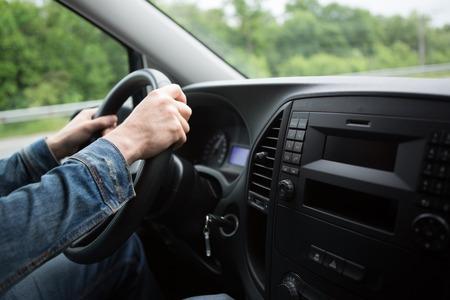 車を運転して男の手がクローズ アップ 写真素材