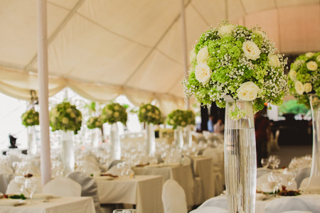 holiday catering: wedding set up in garden inside beach. Closeup of flowers Stock Photo