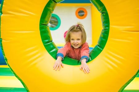 Joyful little girl playing on a trampoline. Archivio Fotografico