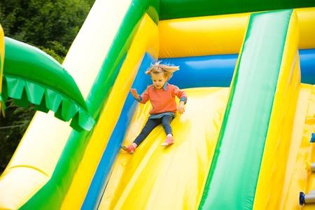 Joyful little girl playing on a trampoline. Standard-Bild