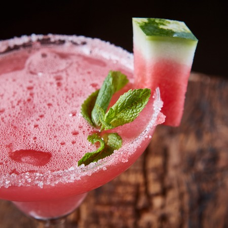 watermelon juice: Watermelon frozen cocktail with copy space on wooden background Stock Photo