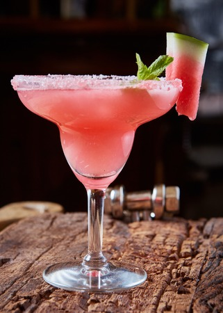 Watermelon frozen cocktail with copy space on wooden background Фото со стока