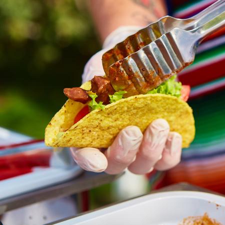 cruda: Chef making tacos at a street cafe. selective focus