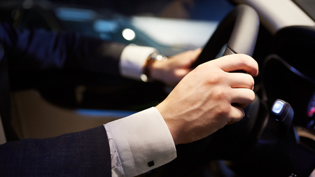 Closeup of hands on a steering wheel