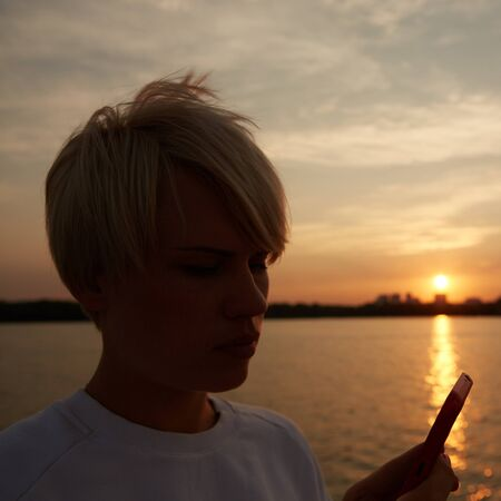 selfy: close-up portrait of a beautiful young blonde woman makes selfy