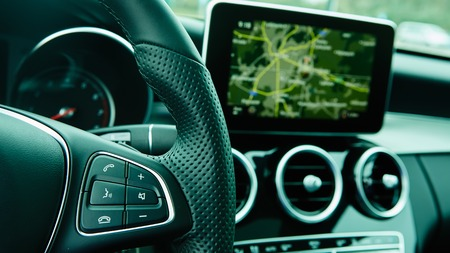 Modern car interior. Shallow DOF. Steering wheel in focus