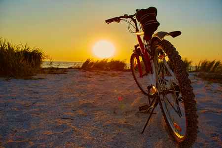 touring: Bicycle at the beach on twilight time Stock Photo