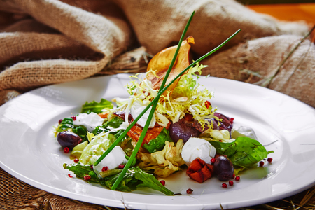 green herbs: Fresh spring salad with feta cheese, red onion in white bowl. background with free text space.