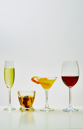 alcohol drinks: set with different drinks on white background - champagne, whiskey, cocktail, wine