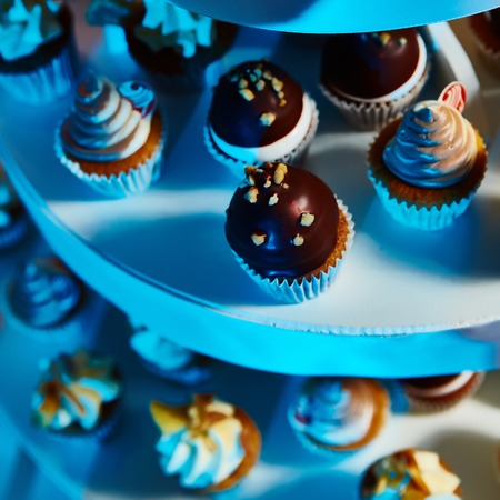 catered: Selection of decorative desserts on a buffet table at a catered luxury event or celebration