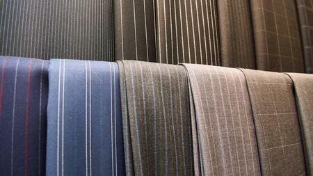 working attire: The various elite suit fabrics close up Stock Photo