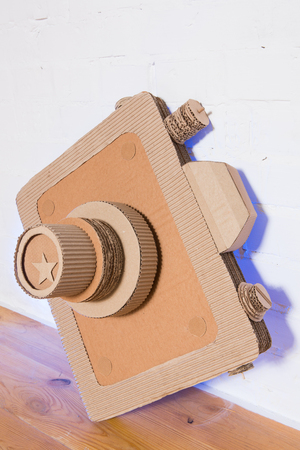 babyish: handmade cardboard camera on a white background Stock Photo