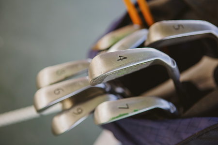 caddie: Dirty golf clubs in bag. Shallow dof Stock Photo