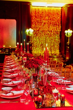 catered: Table set for wedding or another catered event dinner in red colors