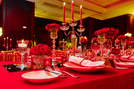 Table set for wedding or another catered event dinner in red colors