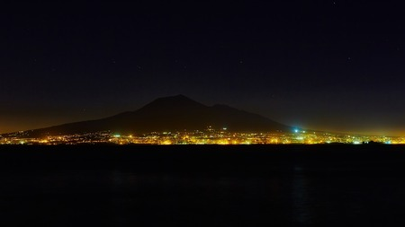 sorrento: The Mount Vesuvius at night, from Sorrento, Italy
