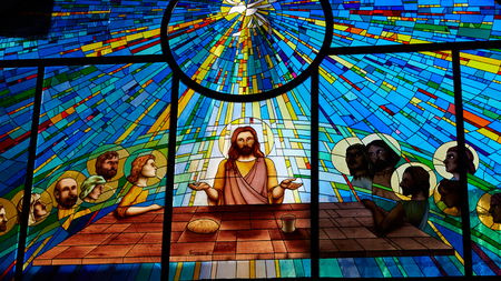 Sorrento, Italy - November 8, 2013: Stained glass window depicting Jesus and the twelve apostles on maundy thursday at the Last Supper in the cathedral