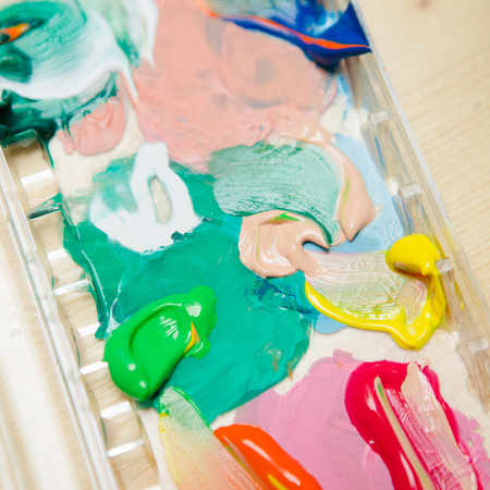 paintbox: Closeup of messy, used water-color paint box. background Stock Photo