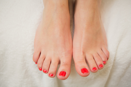 toes: Pretty toes with red nail polish. Shallow dof