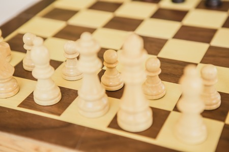 battle plan: Chess. White board with chess figures on it. Plan of battle.