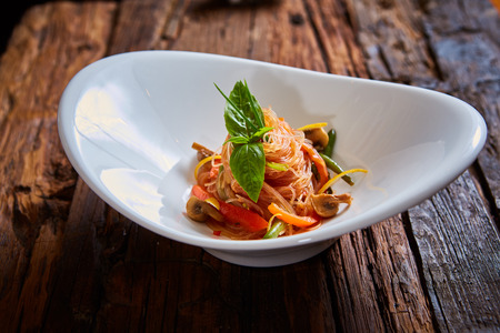 chap sticks: Glass noodles with mushrooms and vegetables. Dish of Korean cuisine Stock Photo