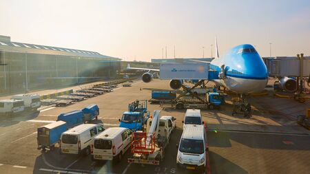 schiphol: Amsterdam, Netherlands - March 11, 2016: KLM plane being loaded at Schiphol Airport