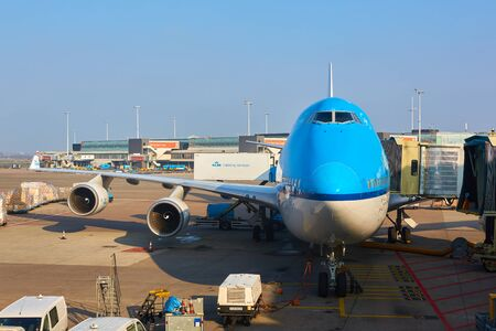 klm: Amsterdam, Netherlands - March 11, 2016: KLM plane being loaded at Schiphol Airport