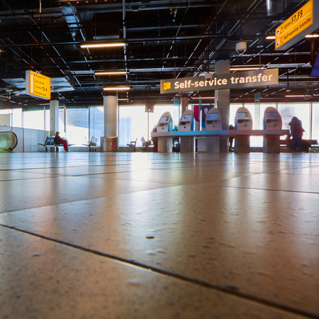 schiphol: Amsterdam, Netherlands - March 11, 2016: self check-in kiosk in Amsterdam Airport Schiphol. Amsterdam Airport Schiphol is the main international airport of the Netherlands. Editorial