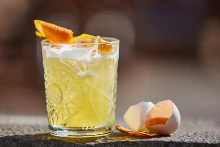 whiskey sour in the sunlight. Shallow dof