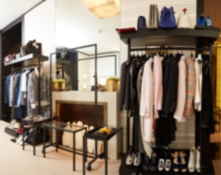 clothing shop: The blurred luxury clothing boutique interior background