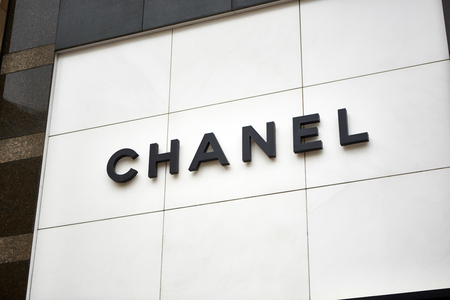 specializes: Kiev, Ukraine - April 12, 2016: Chanel retail store exterior. Chanel is a French high fashion house that specializes in ready-to-wear clothes, luxury goods and fashion accessories.
