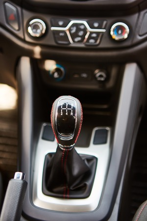 gear  speed: 6 speed gear stick closeup. Manual gearbox in the car