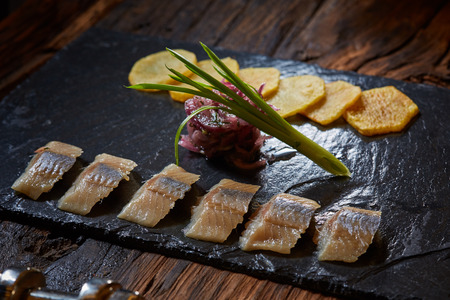 grilled potato: Sliced herring filet with grilled potato and onion Stock Photo