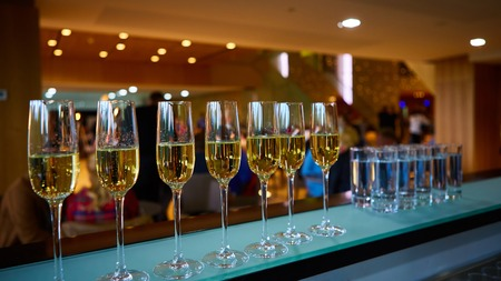 fizzy tablet: A row of champagne glasses. Shallow dof Stock Photo