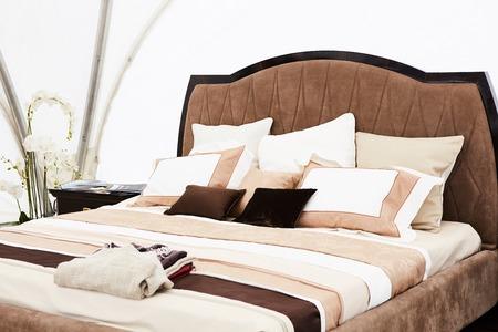 classics: Interior of a bedroom in brown tones. Modern classics