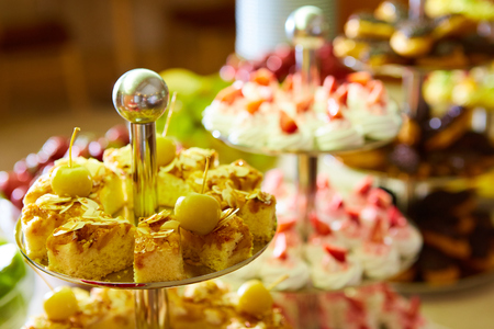 sweetness: Dessert table for a party. akes and sweetness. Shallow dof