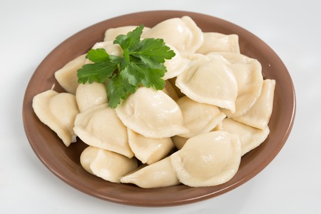 Homemade traditional Russian Ukrainian dumplings, vareniki. Shallow dof