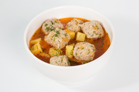 roast potatoes: Meatballs in gravy with roast potatoes and vegetables. Stock Photo