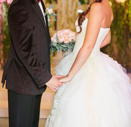 no face: Bride and groom holding hands close up no face. Stock Photo
