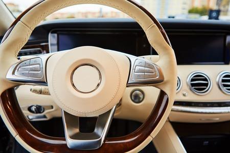 Luxury car Interior. Steering wheel and dashboard Stock Photo