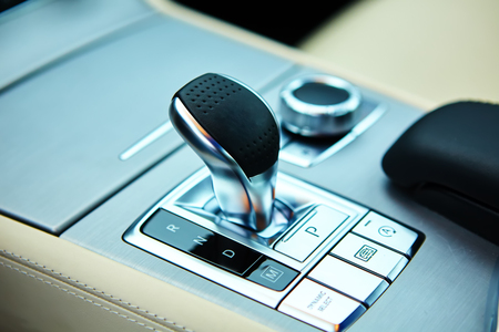 expensive car: Detail of modern car interior, gear stick, automatic transmission in expensive car