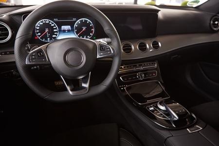 inwards: Luxury car Interior. Steering wheel and dashboard Stock Photo