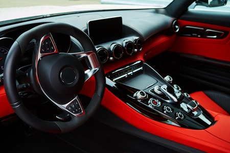 Luxury car Interior. Steering wheel and dashboard Фото со стока